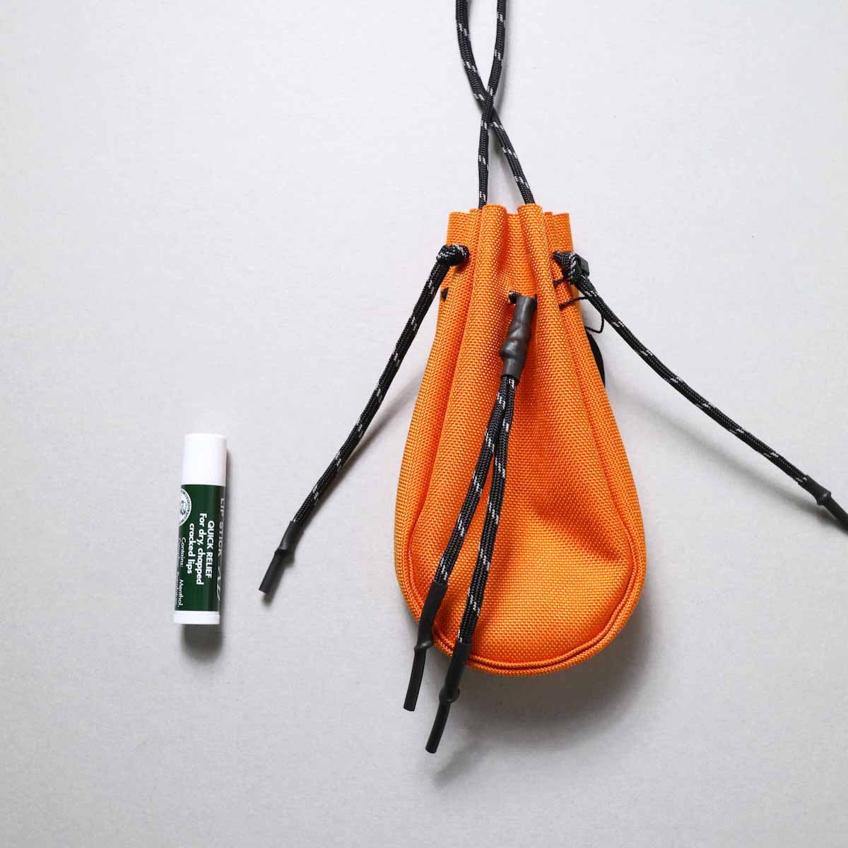 吉岡衣料店 / drawstring bag -XS-. (Orange)