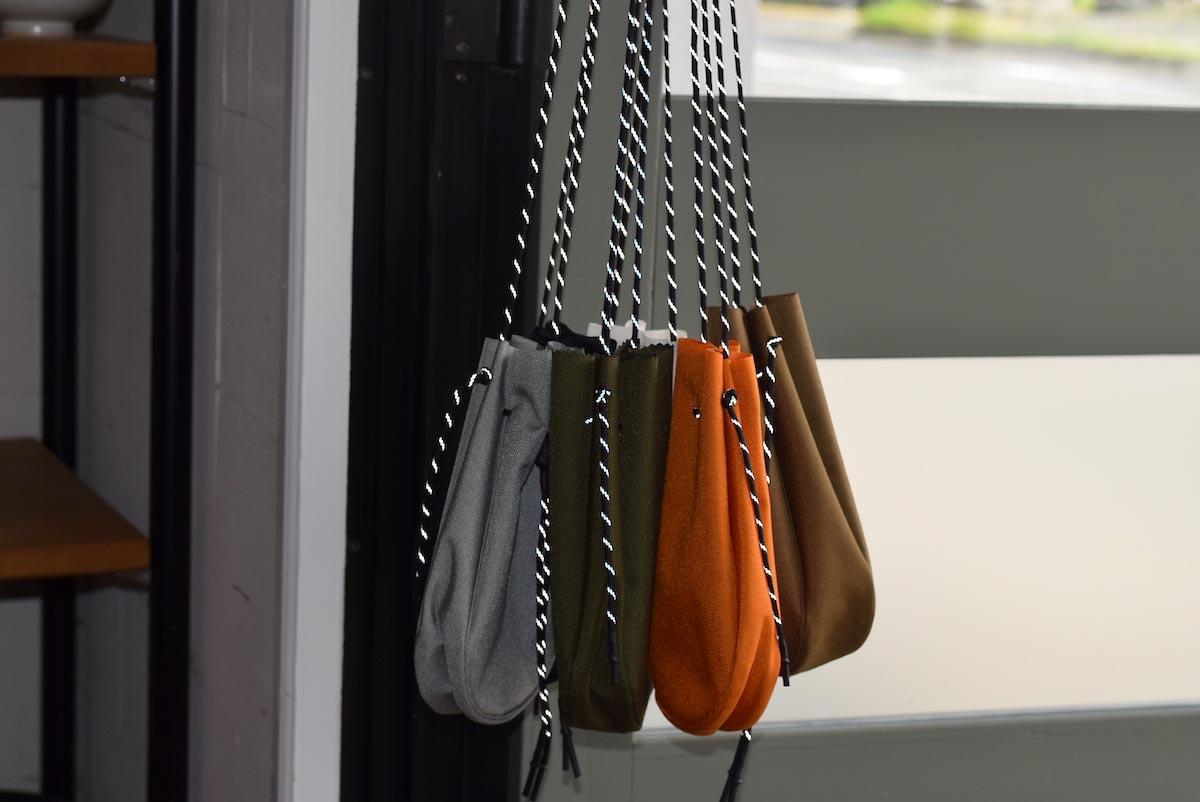 吉岡衣料店 / drawstring bag -L-. w/concho. リフレクトパラコード