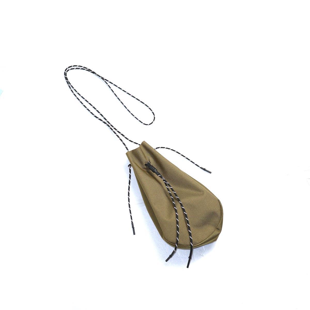 吉岡衣料店 / drawstring bag -L-. (Coyote)  正面