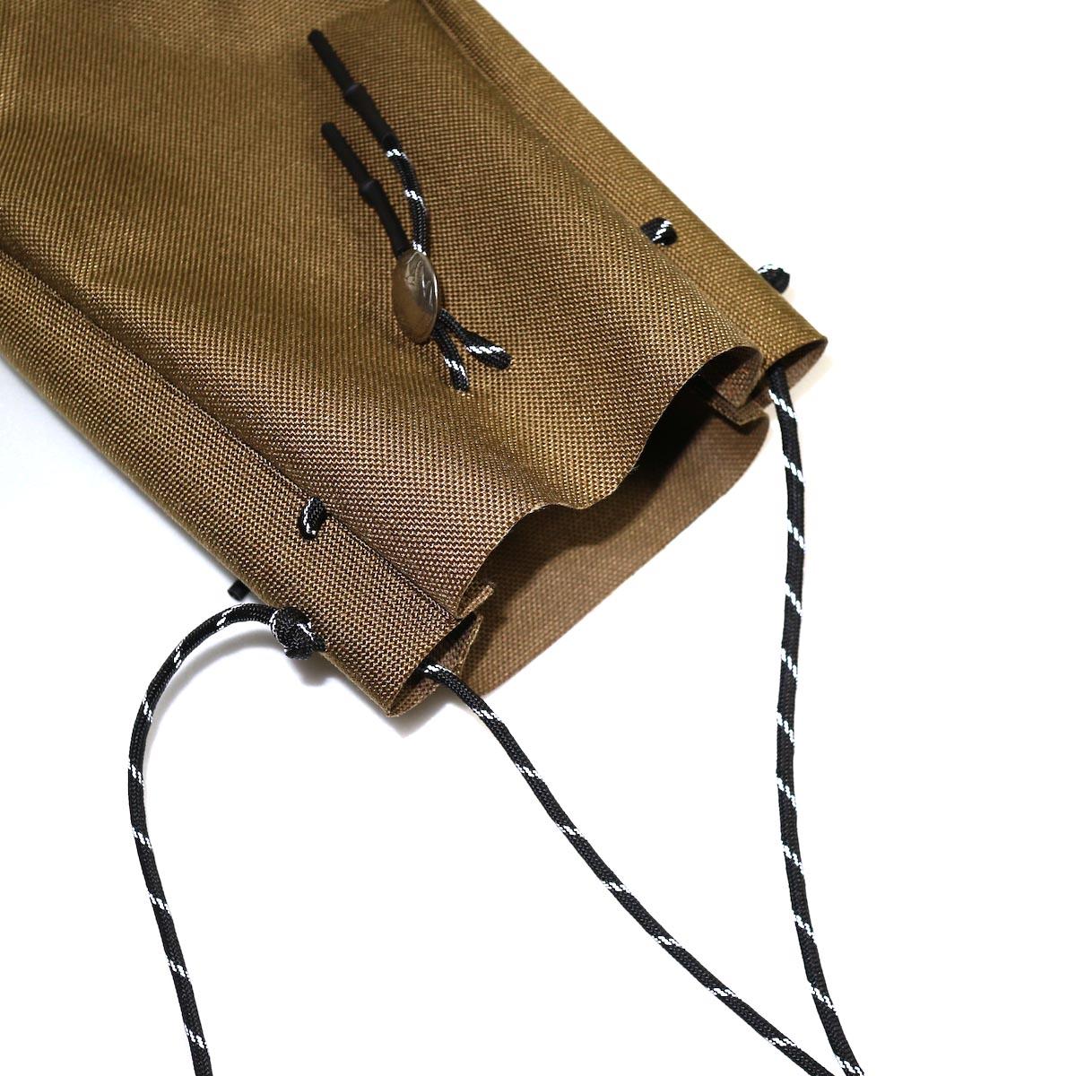 吉岡衣料店 / drawstring bag -S-. w/concho. (Black) 開口部