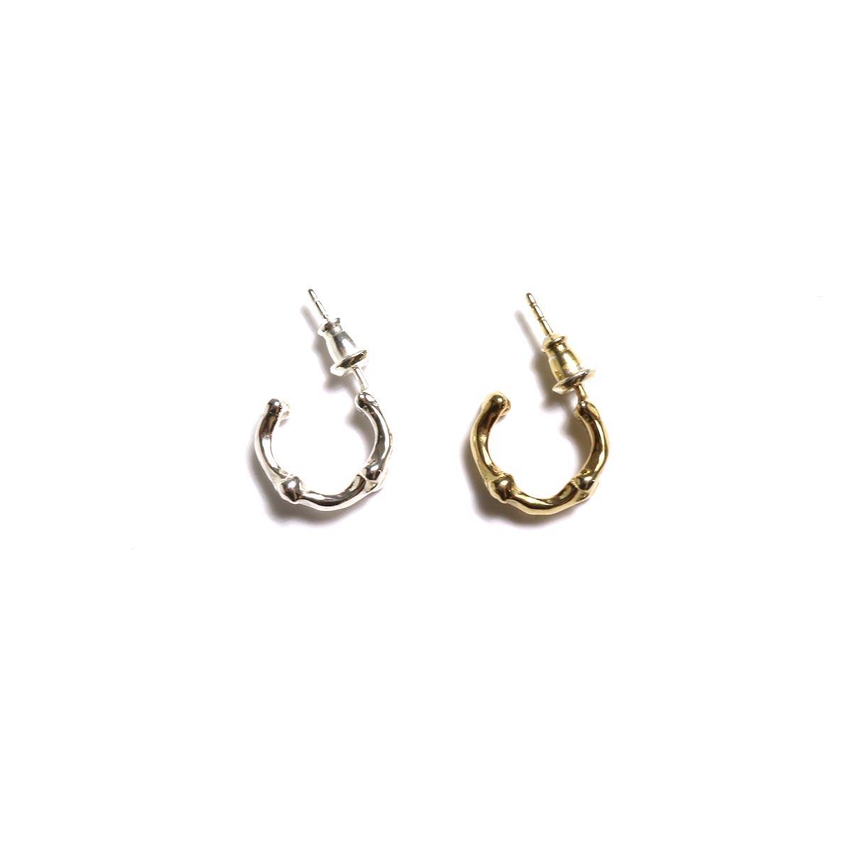 The Soloist / sa.0019AW19 bone shaped earrings.