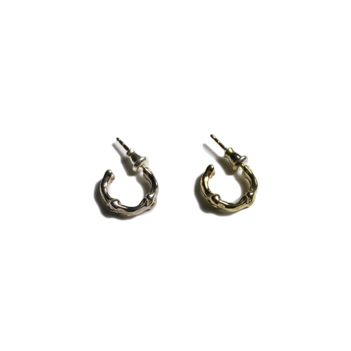 The Soloist / sa.0024SS20 bone shaped earrings.